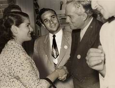 "My parents welcoming the president C. Shamoun during an exibition of ""Universal - Genève"" watches in Beirut - 1955"